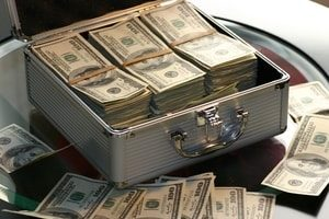 Money in suitcase. Title Loans Long Beach