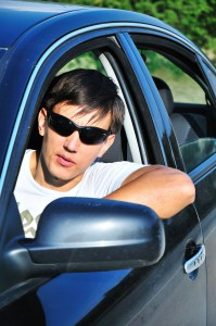 Man with sunglasses driving a car