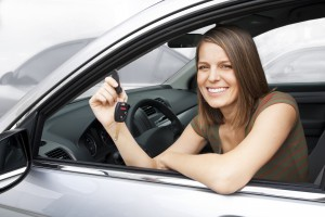 Girl in car with keys. Car Title Loans Wichita Falls
