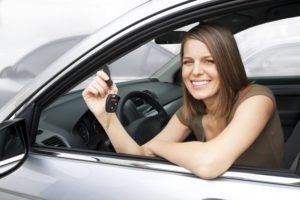 Girl in car with car keys. Perris Title Loans