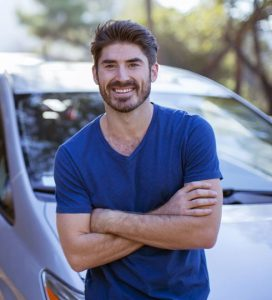 Smiling man with car in background. Title Loans Buena Park