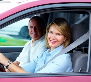 Smiling Woman in red car. Orange Title Loans