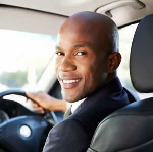 Man inside car smiling