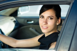 Woman inside car smiling